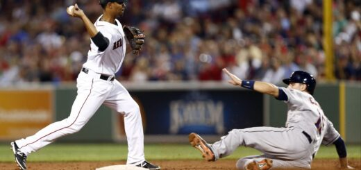 a photo of a baseball infield player about to tag the runner