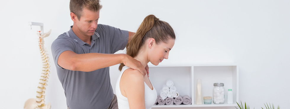 a Chiropractor performing a treatment