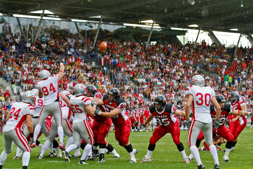 photo showing the start of a football play