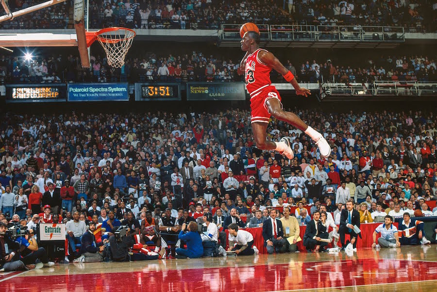 basketball player legend Michael Jordan in the middle of the air to dunk the ball into the oop