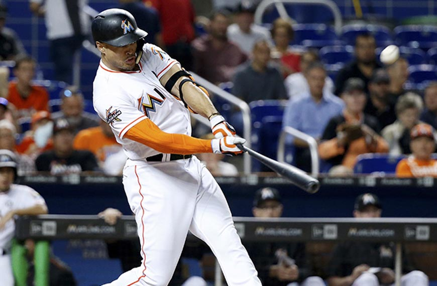 baseball player giancarlo stanton hitting the ball with the bat