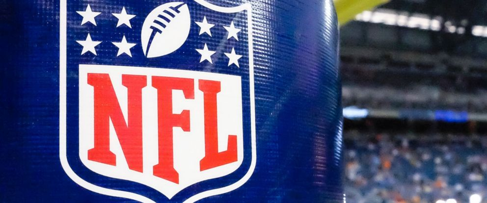 close up photo of NFL logo attached in a field goal post